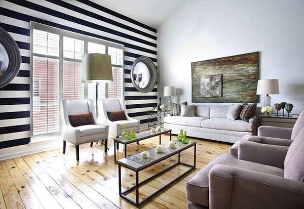 Black-and-white-striped-line-on-living-room-wall-color-with-curved-mirror
