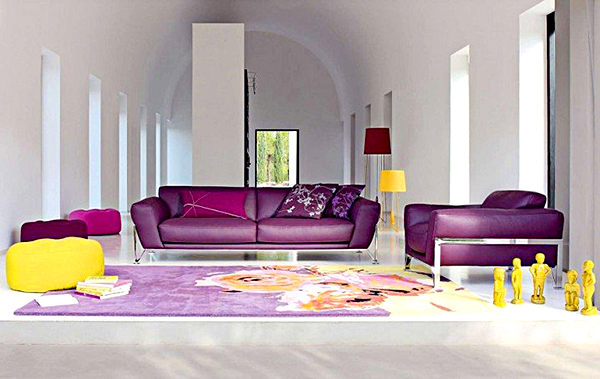 Comfortable-Family-Space-With-Purple-Sofas-Purple-Cushions-Purple-Roche-Bobois-Carpet-And-The-White-Wall-718x454